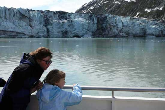 Family watching glaciers in Alaska